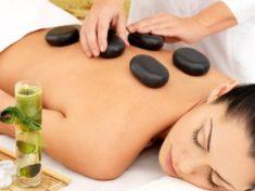 34202179 - woman having hot stone spa  massage of back in beauty salon