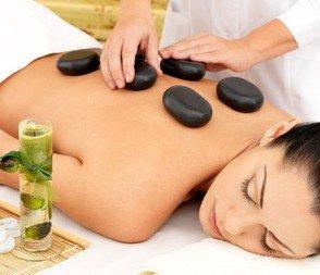 34202179 – woman having hot stone spa  massage of back in beauty salon